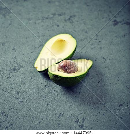 Halved Avocado on a Stone Background