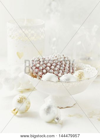 An Arrangement of Vintage Christmas Decorations in White