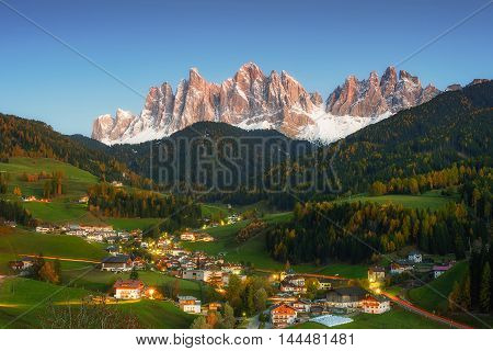 Night landscape with mountain peaks and vilage in valley