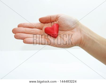 Young Woman Hand With Red Heart