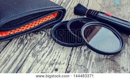 a set of filters to the lens and cleaning brush