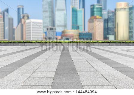 empty tiled floor with city skyline background
