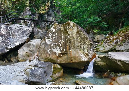 Small charming waterfall in a mountain forest
