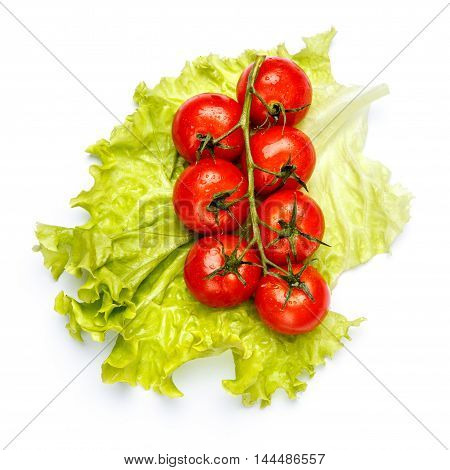 Plum tomatoes with leaves isolated on white background