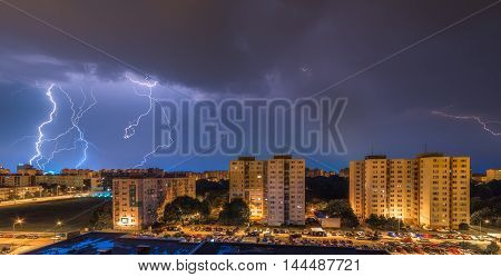 Many Lightnings Over Housing Estate. Night Storm in the City.