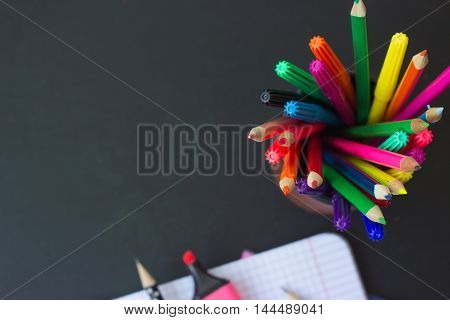 Back to school - notebook and colorful pencils