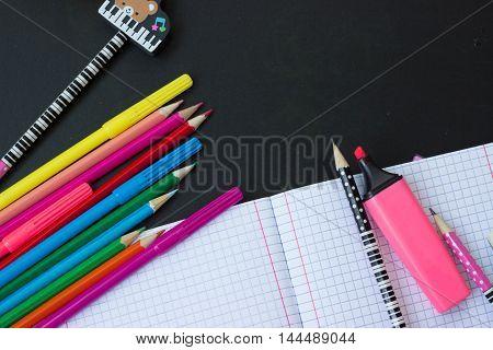 School supplies - notebook, pencils and marker