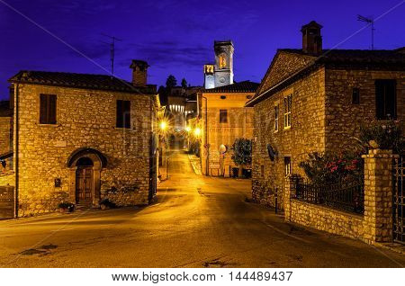 Corciano (Umbria) at blue hour houses detail