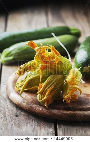 Raw Courgette Flower On The Wooden Table