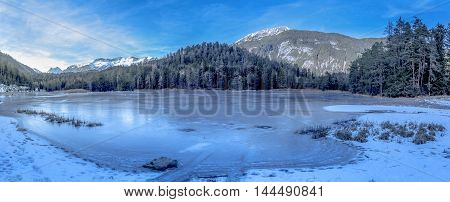 Alpine frozen lake - Winter landscape with a frozen lake and the Austrian Alps in background. Image taken near the village Biberwier from the district Reutte Austria.