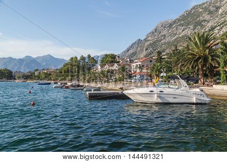 KOTOR MONTENEGRO - 12TH AUGUST 2016: A view along the Kotor waterfront during the summer. Showing yachts boats and buildings.