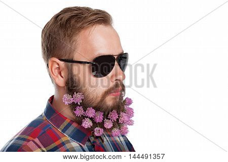 Portrait of handsome man with beard of clover flowers isolated on white