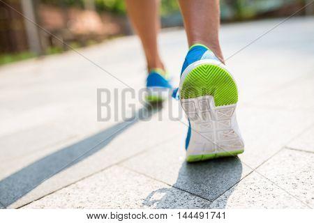 Woman run in a city
