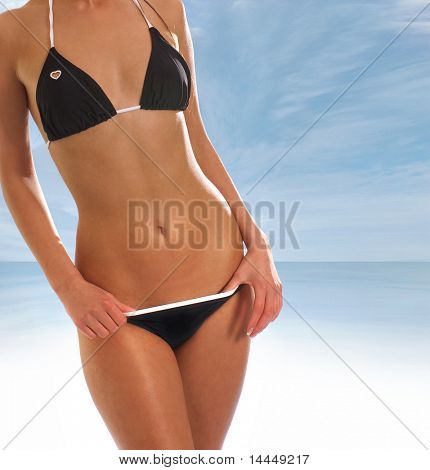Sexy belly over resort background