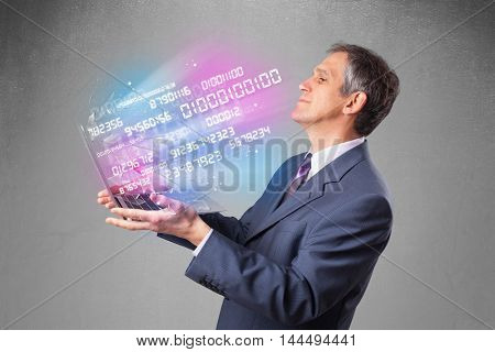 Attractive businessman holding notebook with exploding data and numbers