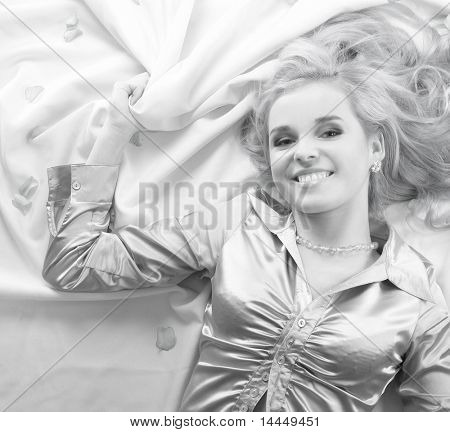 Attractive blond over silk background