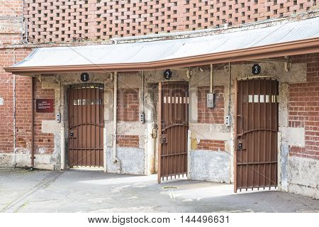 Adelaide, South Australia, Australia - August 14 2016: Metal doors allowing entry to yard 1 2 and 3 from the Circle at the old historic Adelaide Gaol.