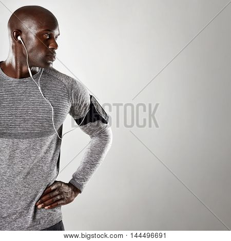African Male Model With Earphone Looking At Copy Space