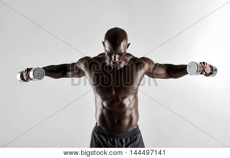 African Man Doing Arms Exercise With Dumbbells