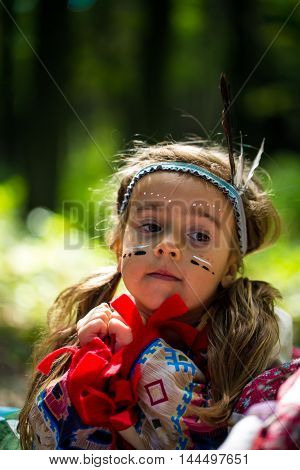 beautiful little girl playing outdoors in Indian portraitemotion