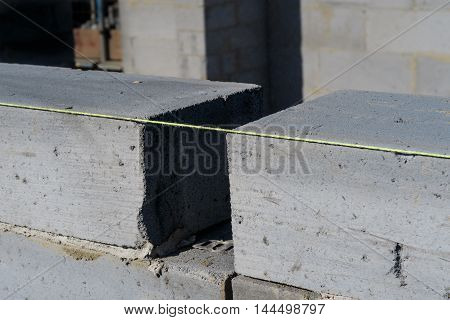 Close up of bricklayer's brick line string and bricks. In England
