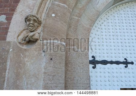 Adelaide South Australia, Australia - August 14 2016: One of the sculptures and part of the gate on the front entrance of the old historic Adelaide Gaol, also known as grotesques.