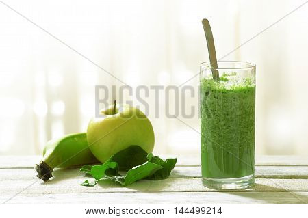 Detox shake with some vegetables and fruits mixed in. Empty copy space for editor's text.