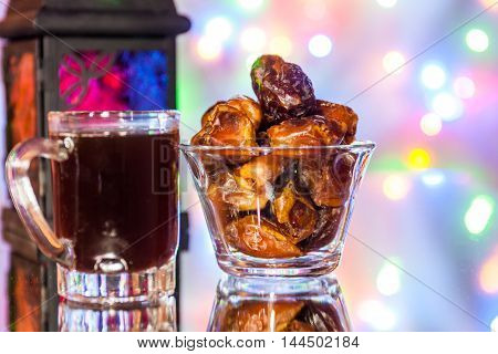 Dates in a glass tumbler and tea