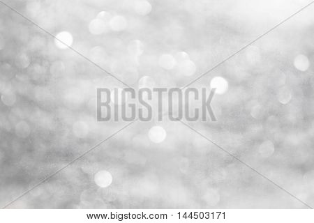 abstract festival texture background with defocused lights. black and white.