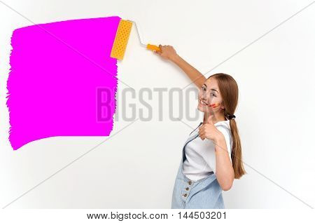 woman holding a paint roller. tools for repair and painting