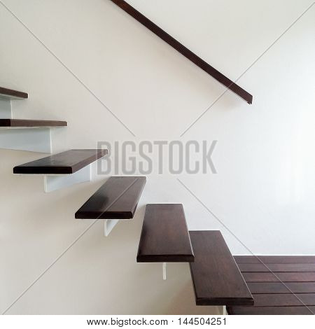 Design stairway consists of metal and wood in luxury home.