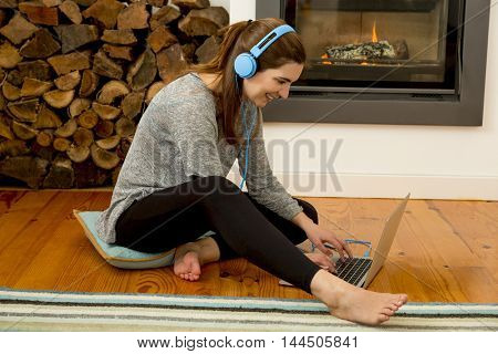 Beautiful woman at home and listen music