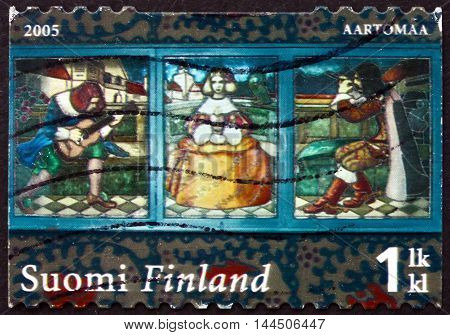 FINLAND - CIRCA 2005: a stamp printed in Finland shows Stained Glass Window by Olga Gummerus-Ehrstrom circa 2005