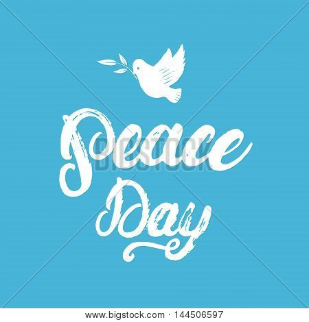 Peace Day hand written calligraphy lettering poster or card with hand drawn dove and olive branch on blue background. Brush ink texture. Vector illustration.