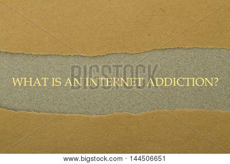 What is An Internet Addiction? question written under torn paper.