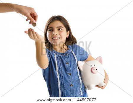 Young girl start her savings on a piggybank