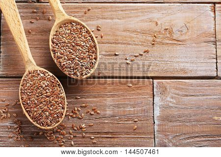 Brown Flax Seeds On A Wooden Table