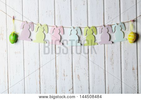 Beautiful Easter Rabbit On White Wooden Background