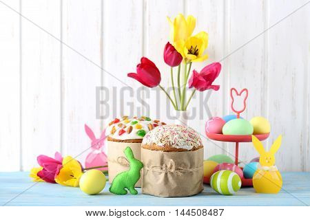 Easter Eggs With Cake On A Blue Wooden Table