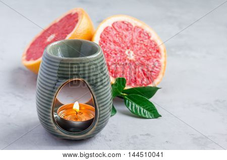 Aromatherapy lamp with grapefruit essential oil copy space horizontal