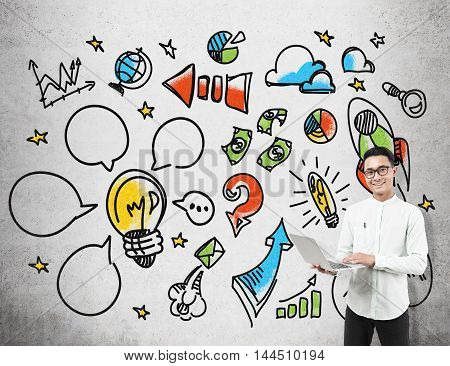 Businessman standing near concrete wall with colorful startup sketch. Concept of IT company foundation.