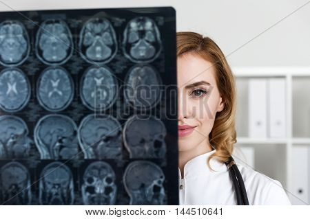 Close Up Of Woman Doctor With X Ray