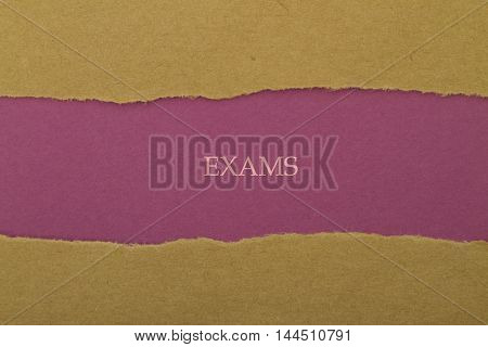 Exams word written under torn paper .