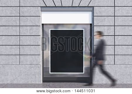 Businessman in glasses going past shop window with framed black poster. Concept of advertisement copyspace. 3d rendering. Mockup