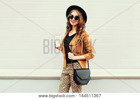 Fashion Happy Young Smiling Woman With Coffee Cup Wearing A Retro Elegant Hat, Sunglasses, Brown Jac