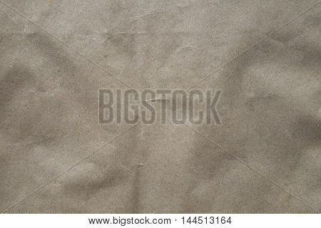 Brown packing paper with crease for background.
