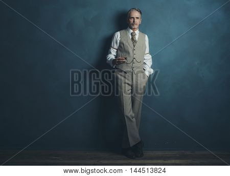 Vintage 1920S Businessman With Glass Of Whiskey Leaning Against Wall.
