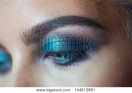 eyes of a beautiful woman with evening make-up.