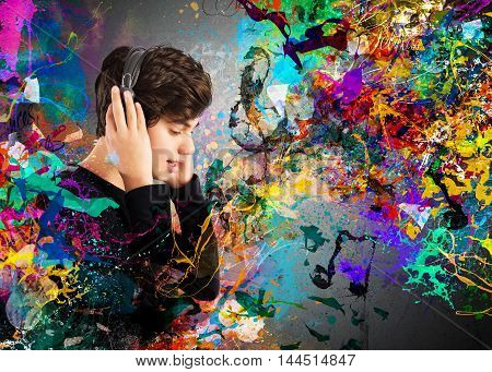 Teen boy listens to music with headphones