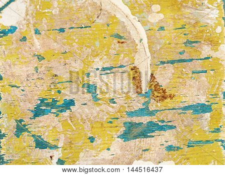 Multicolored background: old wooden multicolored surface with yellow and blue paint and cracking texture